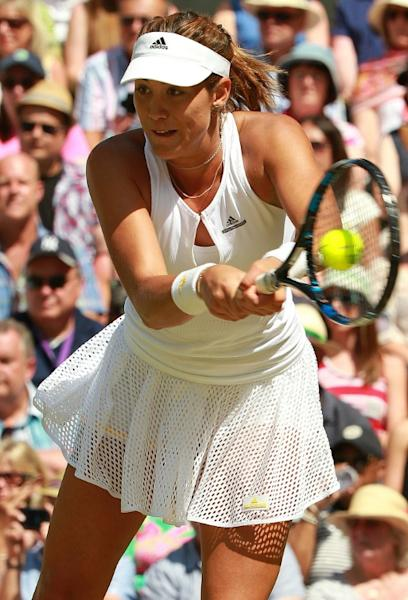 Spain's Garbine Muguruza in action against US rival Serena Williams during the women's singles final during the Wimbledon Championships in southwest London, on July 11, 2015