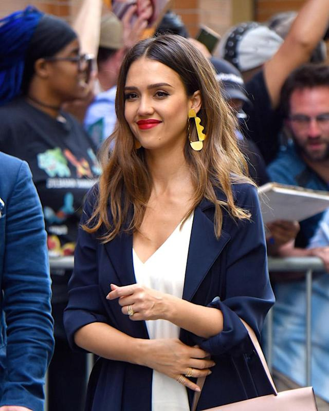 <p>The Honest Company founder and actress was photographed outside the ABC studio in New York City wearing her signature beachy waves, bronzey makeup, and poppy red lipstick. (Photo: Robert Kamau/GC Images) </p>