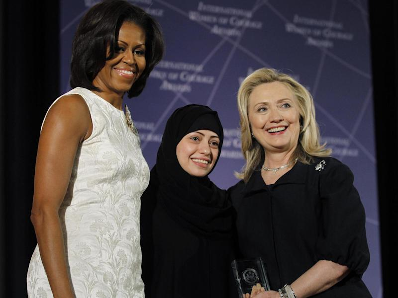 The move is in retaliation for criticism of the arrests of Saudi civil rights activists, including Samar Badawi, pictured above with Michelle Obama and Hillary Clinton: Reuters