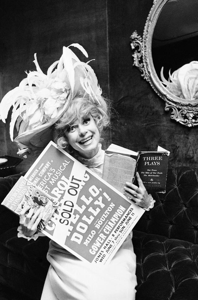 """FILE - In this June 11, 1967 file photo, Carol Channing holds a sold out advertisement poster of """"Hello, Dolly"""" in Houston. Channing, whose career spanned decades on Broadway and on television has died at age 97. Publicist B. Harlan Boll says Channing died of natural causes early Tuesday, Jan. 15, 2019 in Rancho Mirage, Calif. (AP Photo/Ed Kolenovsky, File)"""