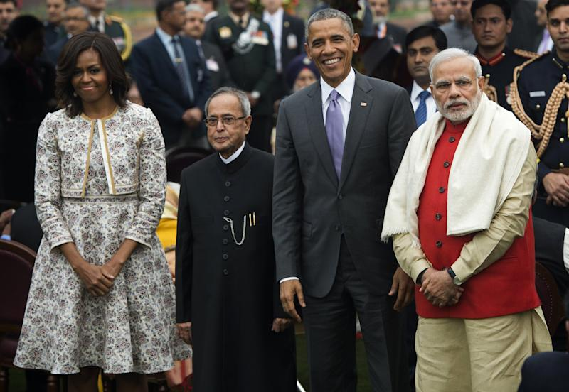 U.S. President Barack Obama; Indian Prime Minister Narendra Modi, right; Indian President Pranab Mukherjee, second from the left; and First Lady Michelle Obama attend a reception at Rashtrapati Bhawan, the Presidential Palace, in New Delhi on Jan. 26, 2015. | Saul Loeb–AFP/Getty Images