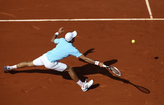 Serbia's Novak Djokovic returns the ball to Spain's Rafael Nadal during their final match of the French Open tennis tournament at the Roland Garros stadium, in Paris, France, Sunday, June 8, 2014. (AP Photo/David Vincent)