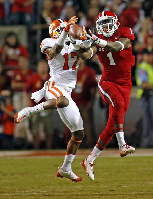 Clemson's Bashaud Breeland (17) breaks up a pass intended for North Carolina State's Marquez Valdes-Scantling (1) during the second half of an NCAA college football game in Raleigh, N.C., Thursday, Sept. 19, 2013. Clemson won 26-14. (AP Photo/Karl B DeBlaker)