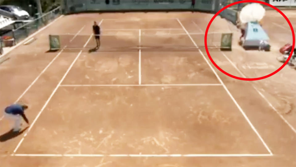 The ball girl, pictured here almost being crushed after the umpire's chair collapsed.