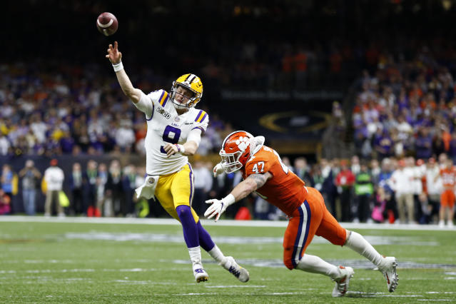 LSU quarterback Joe Burrow passes under pressure from Clemson linebacker James Skalski during the first half of a NCAA College Football Playoff national championship game Monday, Jan. 13, 2020, in New Orleans. (AP Photo/Gerald Herbert)