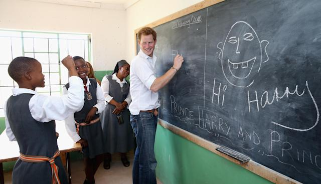 MASERU, LESOTHO - FEBRUARY 27: Prince Harry learns sign language from deaf children during at visit to the Kananelo Centre for the deaf, a project supported by his charity Sentebale on February 27, 2013 in Maseru, Lesotho. Sentebale is a charity founded by Prince Harry and Prince Seeiso of Lesotho. It helps the most vulnerable children in Lesotho get the support they need to lead healthy and productive lives. Sentebale works with local grassroots organisations to help these children, the victims of extreme poverty and Lesotho's HIV/AIDS epidemic. Cathy Ferrier was appointed as Sentebale's Chief Executive in March 2012 and is spearheading a fundraising initiative to build the Mamohato Centre which will provide psychosocial support for children and young people infected with HIV. Prince Harry is due to pay a visit to Lesotho this week to catch up on his charity's progress and meet key children who will be supported by the charity. (Photo by Chris Jackson/Getty Images)