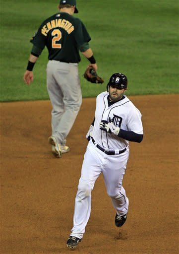 Detroit Tigers' Alex Avila rounds second base after hitting a solo home run during the fifth inning of Game 1 of the American League division baseball series against the Oakland Athletics, Saturday, Oct. 6, 2012, in Detroit. (AP Photo/Carlos Osorio)