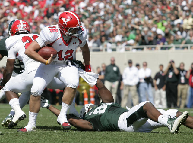 Michigan State's Shilique Calhoun, right, pulls down Youngstown State quarterback Kurt Hess (12) for a sack during the second quarter of an NCAA college football game, Saturday, Sept. 14, 2013, in East Lansing, Mich. (AP Photo/Al Goldis)