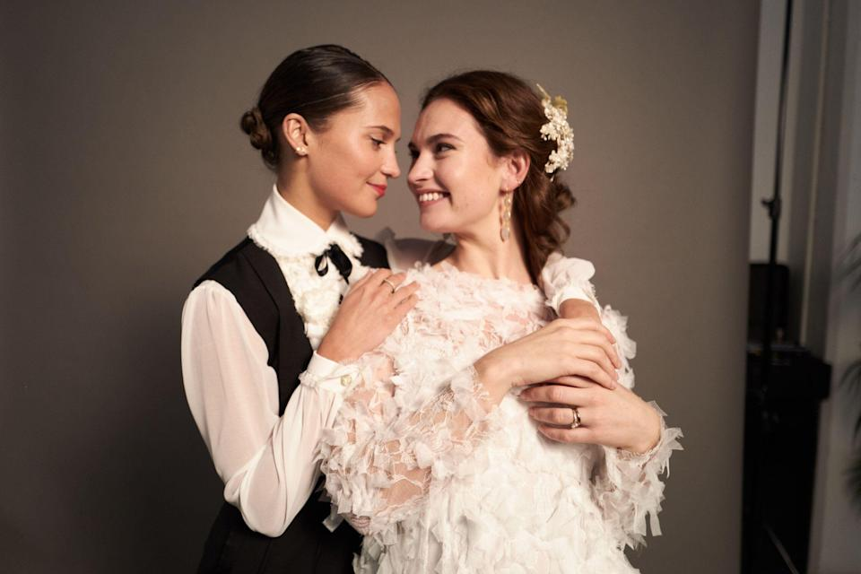 Exclusive image of Alicia Vikander and Lily James celebrating their wedding in 'One Red Nose Day and a Wedding,' a 15-minute sequel to 'Four Weddings and a Funeral' to air on NBC on May 23