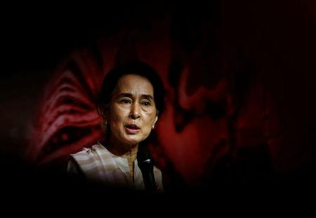 FILE PHOTO: Myanmar's opposition leader Suu Kyi speaks to the Myanmar community living in Singapore, on the island of Sentosa