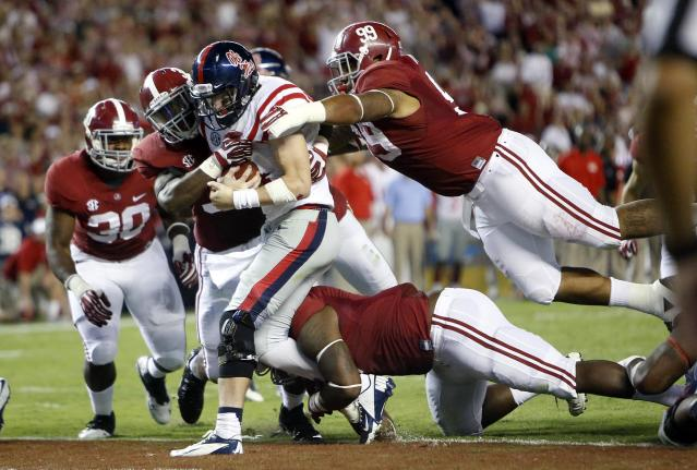 CORRECTS NAME OF ALABAMA DEFENDER AT BOTTOM TO JEOFFREY PAGAN, DELETES OTHER NAME - Alabama defenders, including Brandon Ivory (99), C.J. Mosley (32) and Jeoffrey Pagan, bottom, bring down Mississippi quarterback Bo Wallace (14) in the end zone for a safety in the fourth quarter of an NCAA college football game in Tuscaloosa, Ala., Saturday, Sept. 28, 2013. (AP Photo/Tuscaloosa News, Dusty Compton)