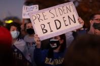 Biden supporters gather just outside the security perimeter of a planned election celebration as they await his remarks and fireworks in Wilmington, Delaware
