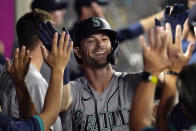 Seattle Mariners' Mitch Haniger is congratulated by teammates after hitting a two-run home run during the seventh inning of a baseball game against the Los Angeles Angels Friday, July 16, 2021, in Anaheim, Calif. (AP Photo/Mark J. Terrill)