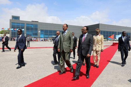 Eritrea's President Isaias Afwerki (L) is welcomed by Somalia's President Mohamed Abdullahi Mohamed as he arrives at the Aden Abdulle International Airport in Mogadishu, Somalia December 13, 2018. REUTERS/Feisal Omar
