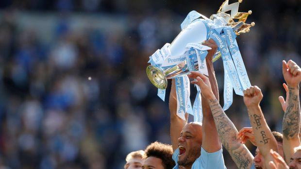 Manchester City lift the Premier League trophy in May 2019