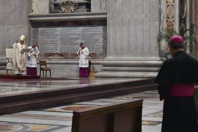 Pope Francis delivers his message in St Peter's Basilica, which was largely empty Virus Outbreak Vatican Holy Thursday