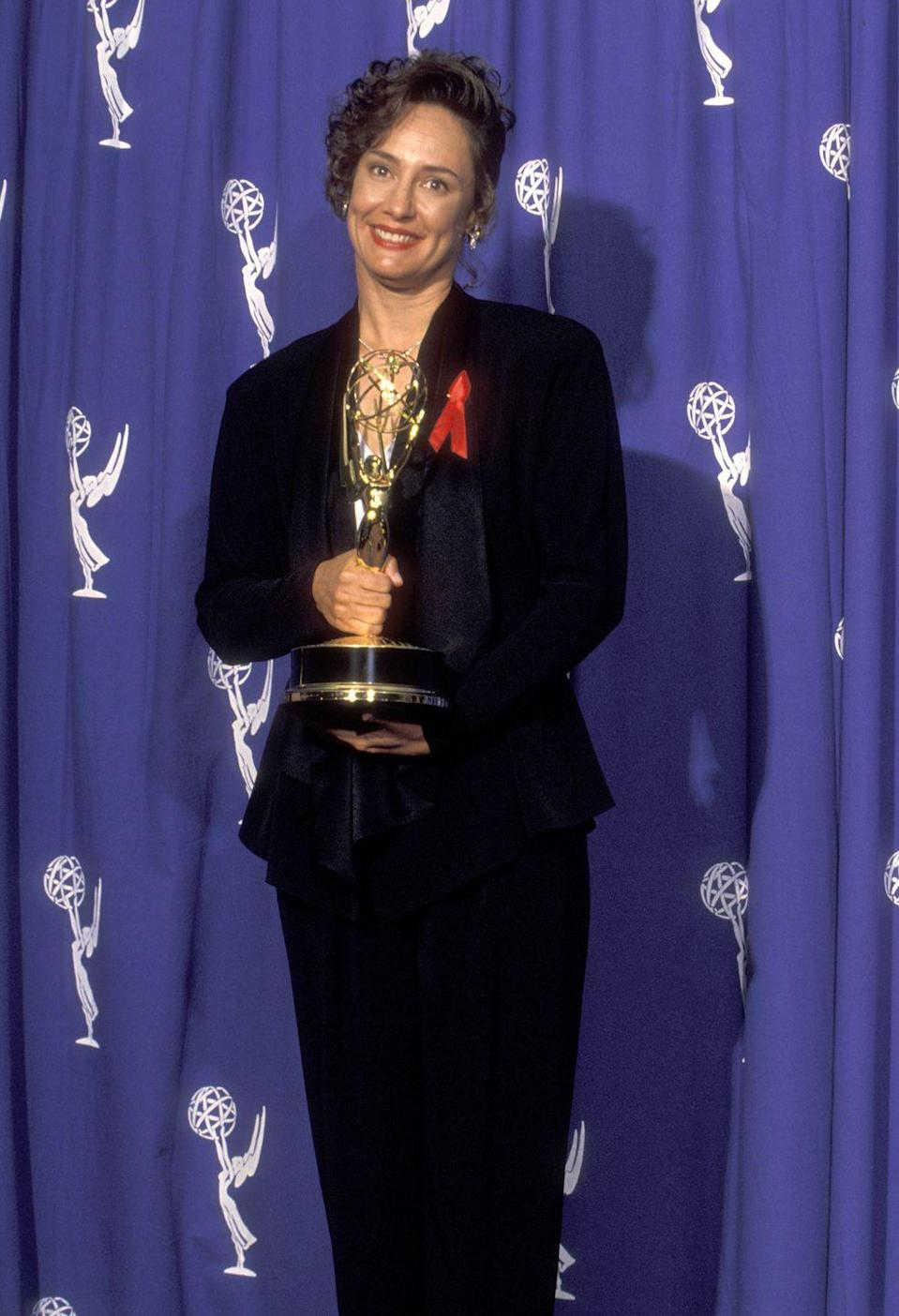"""<p>Metcalf wore a classic black pantsuit when she won her Emmy for Outstanding Supporting Actress in a Comedy Series for her role on <em>Roseanne</em><span class=""""redactor-invisible-space""""> in 1993. </span></p>"""