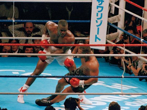 James Douglas drops Mike Tyson to the canvas in the 10th round of their heavyweight champion bout (AP)