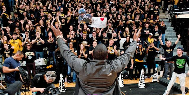 Michael Sam acknowledges fans during the Cotton Bowl trophy presentation at halftime of a basketball game between Missouri and Tennessee in Columbia, Missouri -- five days after he announced to the world he is gay. (AP)