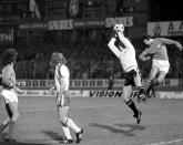 FILE - In this Nov. 19, 1975 file photo, England's goalkeeper Ray Clemence, second right, saves the ball from an attacking Portugese player, unnamed, during the European Nations Cupmatch in Lisbon, Portugal. Ray Clemence, the former Liverpool, Tottenham and England goalkeeper, has died. He was 72. The Football Association confirmed the news Sunday, Nov. 15, 2020 without giving a cause of death. (AP Photo, File)
