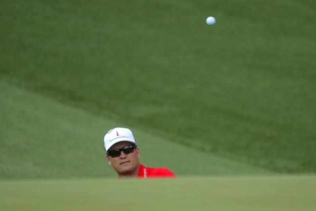 Zach Johnson of the U.S. chips onto the 10th green during second round play of the 2018 Masters golf tournament at the Augusta National Golf Club in Augusta, Georgia, U.S., April 6, 2018. REUTERS/Brian Snyder