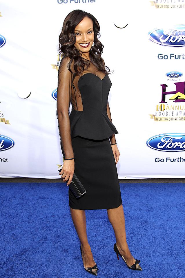 "Selita Ebanks stole the spotlight at the 10th Annual Ford Hoodie Awards in a sexy, peplum-enhanced Stella McCartney dress and bow-adorned Christian Louboutin ""Love Me"" pumps. Voluminous waves and dark lipstick added even more drama to her already sizzling ensemble. (8/4/2012) Follow omg! on Twitter!"