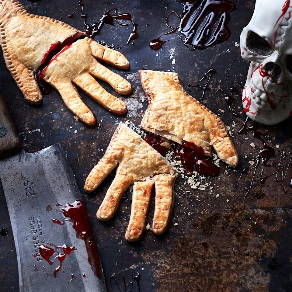 """<p>This freaky-delicious treat serves up classic flavors with a Halloween twist. Impress your guests with sweet cherry filling in flakey puff pastry... in the shape of a human hand.</p> <p><a href=""""https://www.myrecipes.com/recipe/severed-hand-pies"""">Severed Hand Pies Recipe</a></p>"""