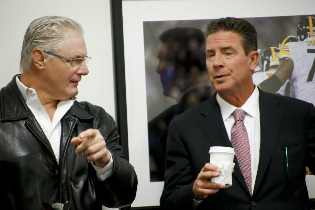 Former Pittsburgh lineman Bill Fralic, left, and NFL Hall of Fame member, Pitt quarterback Dan Marino chat at a news conference in 2015. Fralic finished in the top 10 of the Heisman voting on two occasions. AP Photo/Keith Srakocic)