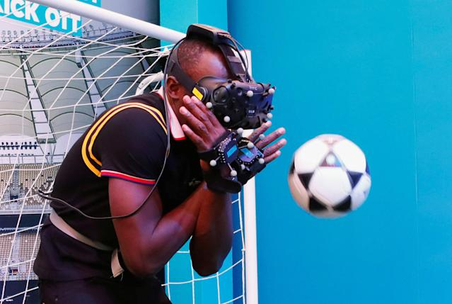 Gold Coast 2018 Commonwealth Games - Gold Coast, Australia - April 12, 2018. Former Jamaican sprinter Usain Bolt plays with a ball while wearing a VR headset. REUTERS/David Gray TPX IMAGES OF THE DAY