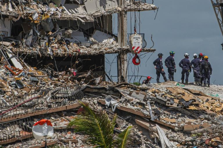 Experts are looking at possible pre-existing critical flaws in the structure of the apartment tower as rescue teams from Florida and abroad work around the clock to scour the debris for signs of life