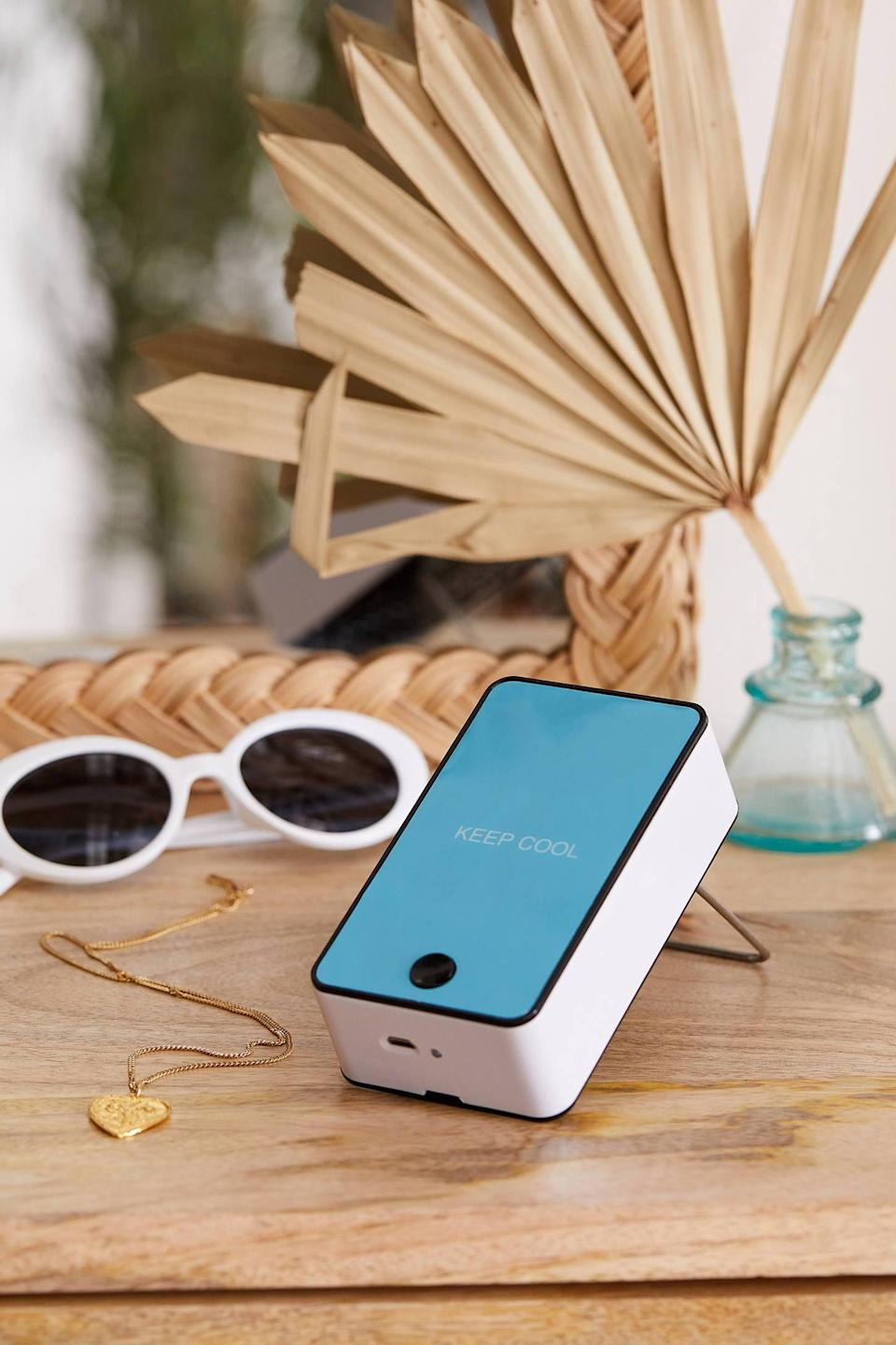 """<p>They can take this <a href=""""https://www.popsugar.com/buy/Portable-Air-Cooler-496552?p_name=Portable%20Air%20Cooler&retailer=urbanoutfitters.com&pid=496552&price=18&evar1=geek%3Aus&evar9=26294675&evar98=https%3A%2F%2Fwww.popsugar.com%2Fnews%2Fphoto-gallery%2F26294675%2Fimage%2F46728734%2FPortable-Air-Cooler&list1=shopping%2Cgadgets%2Choliday%2Cgift%20guide%2Choliday%20living%2Ctech%20gifts%2Cgifts%20under%20%24100&prop13=api&pdata=1"""" class=""""link rapid-noclick-resp"""" rel=""""nofollow noopener"""" target=""""_blank"""" data-ylk=""""slk:Portable Air Cooler"""">Portable Air Cooler</a> ($18) anywhere.</p>"""
