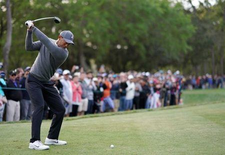Mar 8, 2018; Palm Harbor, FL, USA; Tiger Woods tees off on the 18th during the first round of the Valspar Championship golf tournament at Innisbrook Resort - Copperhead Course. Jasen Vinlove-USA TODAY Sports