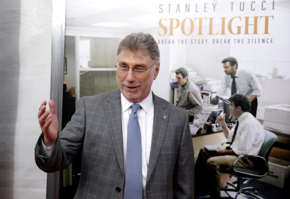 """FILE - Marty Baron, former editor of The Boston Globe, walks the red carpet as he attends the Boston area premiere of the film """"Spotlight"""" in Brookline, Mass. on Oct. 28, 2015. Baron, executive editor of The Washington Post and one of the nation's top journalists, says he will retire at the end of February. He took over the Post's newsroom in 2012 after editing the Boston Globe and Miami Herald before that. He was portrayed in the 2015 movie """"Spotlight"""" about the Globe's investigation of the Catholic Church. (AP Photo/Steven Senne, File)"""