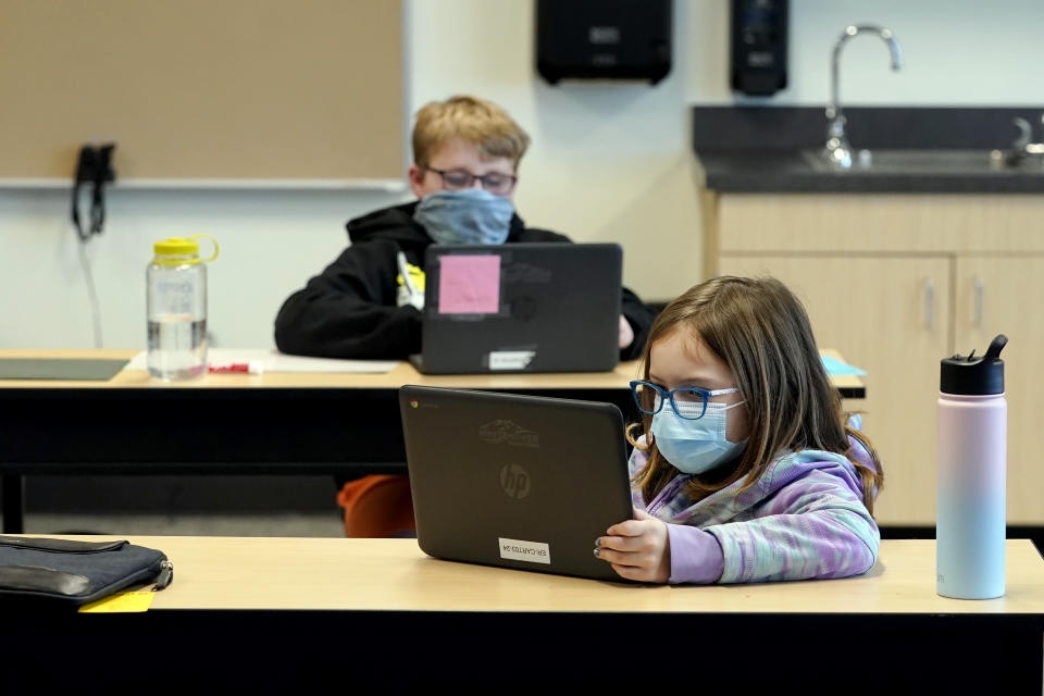 FILE - In this Feb. 2, 2021 file photo, students wear masks as they work in a fourth-grade classroom, at Elk Ridge Elementary School in Buckley, Wash. After seeing two academic years thrown off course by the pandemic, school leaders around the country are planning for the possibility of more distance learning next fall at the start of yet another school year. (AP Photo/Ted S. Warren, File)