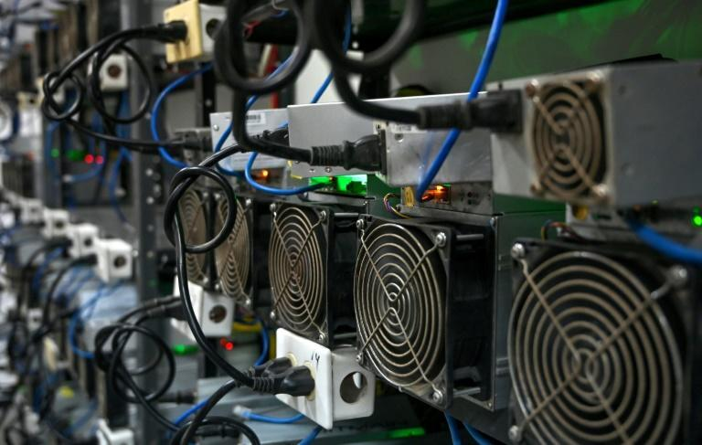 In Venezuela, a country in recession and contending with the world's highest inflation of nearly 3,000 percent in 2020, crypto mining presents a rare opportunity for making money (AFP/Federico PARRA)