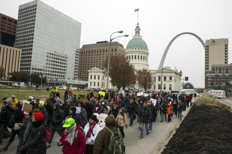 Demonstrators march to City Hall as they protest a grand jury's decision not to indict police officer Darren Wilson for killing Michael Brown, in St. Louis