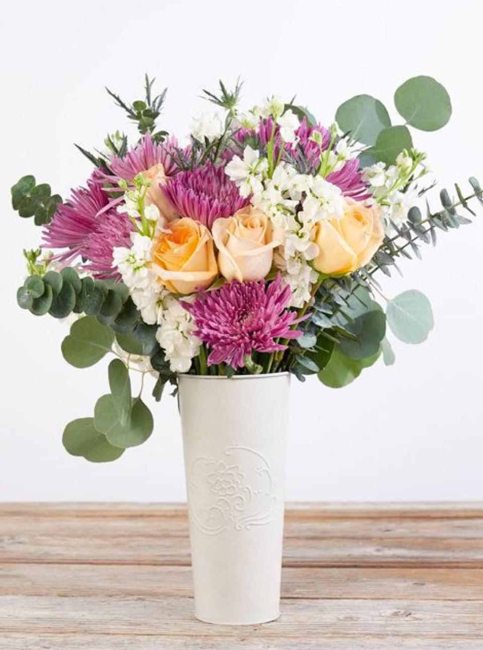 """Consider getting Mom a gift that repeats itself—meaning a monthly flower subscription service to The Bouqs Co. The company ships to all 50 states, and the member perks are really good. We're talking 30% off seasonal blooms, plus she can always redirect the gift to friends one month or skip deliveries. $79, Mums for Mom. <a href=""""https://bouqs.com/flowers/tiffani-thiessen/mums-roses-eucalyptus?"""" rel=""""nofollow noopener"""" target=""""_blank"""" data-ylk=""""slk:Get it now!"""" class=""""link rapid-noclick-resp"""">Get it now!</a>"""
