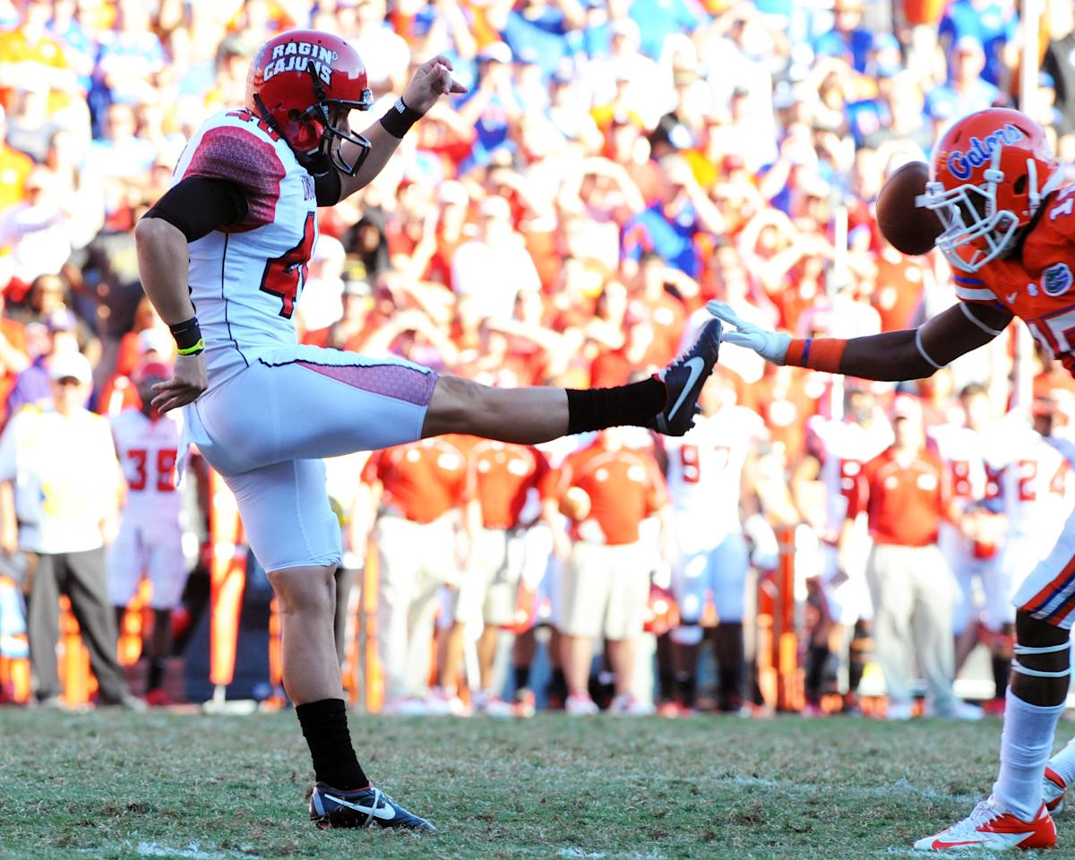 GAINESVILLE, FL - NOVEMBER 10: Defensive back Loucheiz Purifoy #15 of the Florida Gators blocks a punt by Brett Baer #40 of the Louisiana-Lafayette Ragin' Cajuns in the fourth quarter to set up a game-winning touchdown November 10, 2012 in Gainesville, Florida. Florida won 27 - 20. Florida won 27 - 20. (Photo by Al Messerschmidt/Getty Images)