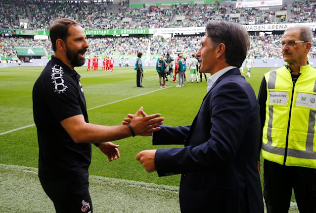 Soccer Football - Bundesliga - VfL Wolfsburg v FC Cologne - Volkswagen Arena, Wolfsburg, Germany - May 12, 2018 Wolfsburg coach Bruno Labbadia and Cologne coach Stefan Ruthenbeck before the match REUTERS/Wolfgang Rattay DFL RULES TO LIMIT THE ONLINE USAGE DURING MATCH TIME TO 15 PICTURES PER GAME. IMAGE SEQUENCES TO SIMULATE VIDEO IS NOT ALLOWED AT ANY TIME. FOR FURTHER QUERIES PLEASE CONTACT DFL DIRECTLY AT + 49 69 650050