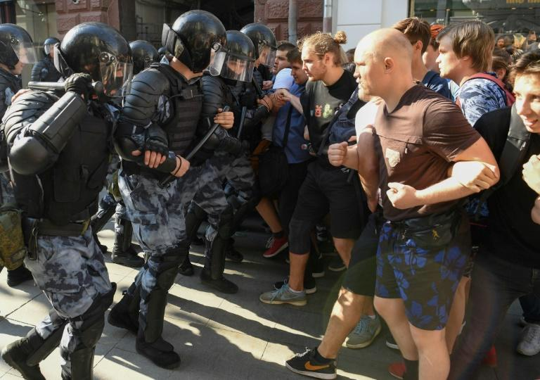 Protesters clash with riot police during an unauthorised rally demanding independent and opposition candidates be allowed to run for office in September's Moscow election
