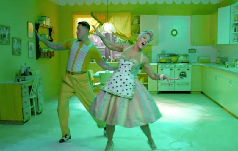 The pair enjoy a bit of jiving together. How very 1950s. Source: YouTube / Vevo