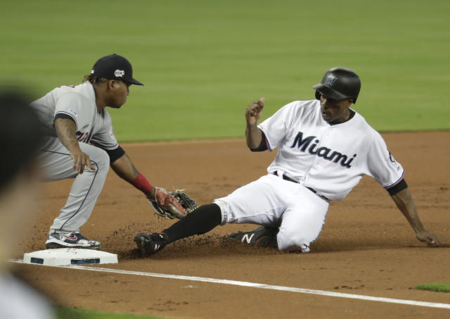 Miami Marlins' Curtis Granderson, right, is tagged out at third by Cleveland Indians third baseman Jose Ramirez during the first inning of a baseball game Wednesday, May 1, 2019, in Miami. (AP Photo/Lynne Sladky)