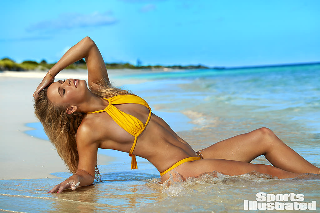<p>Regrets? Rory McIlroy must have a few. His gorgeous ex-fiancée, the Danish tennis pro, showed off her off-court moves as she posed on a sandy beach in Turks and Caicos wearing a lot less than her tennis whites. Wozniacki, who rocked the heck out of that two-piece yellow bikini, just went public with her romance with San Antonio Spurs player David Lee. (Photo: Emmanuelle Hauguel/Sports Illustrated) </p>