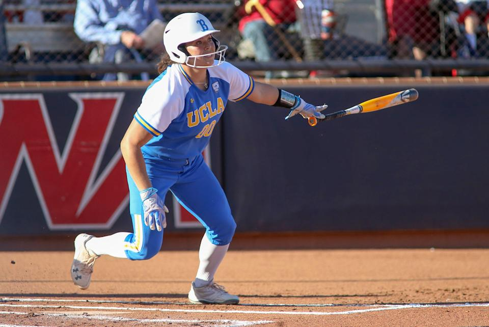 TUCSON, AZ - APRIL 15: UCLA Bruins starting pitcher/relief pitcher Rachel Garcia (00) hits a home run during a college softball game between the UCLA Bruins and the Arizona Wildcats on April 15, 2018, at Hillenbrand Stadium in Tucson, AZ. UCLA Bruins defeated Arizona Wildcats 10-3. (Photo by Jacob Snow/Icon Sportswire via Getty Images)