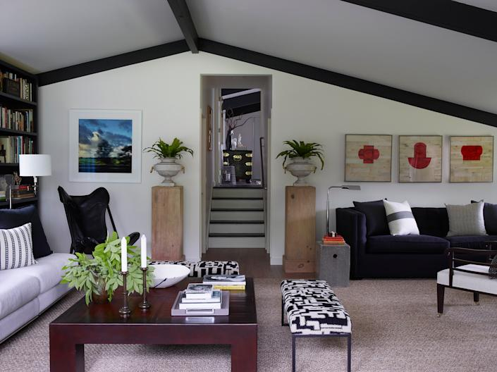 """<div class=""""caption""""> Artwork in the office includes a photo by Smyth and a collection of collages by Robert Courtright. The black leather butterfly-style chair is a rare <a href=""""https://www.gucci.com/us/en/"""" rel=""""nofollow noopener"""" target=""""_blank"""" data-ylk=""""slk:Gucci"""" class=""""link rapid-noclick-resp"""">Gucci</a> piece from the 1960s. </div>"""