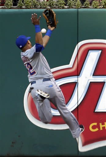 New York Mets right fielder Juan Lagares cannot reach a ball hit for a two-run single by St. Louis Cardinals' Allen Craig during the first inning of a baseball game Tuesday, May 14, 2013, in St. Louis. (AP Photo/Jeff Roberson)