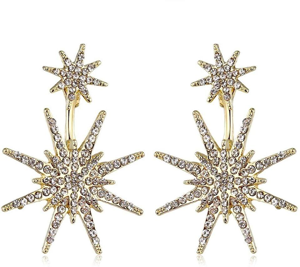 """<p>These <a href=""""https://www.popsugar.com/buy/Gold-Star-Statement-Dangle-Earrings-512902?p_name=Gold%20Star%20Statement%20Dangle%20Earrings&retailer=amazon.com&pid=512902&price=9&evar1=fab%3Aus&evar9=45460850&evar98=https%3A%2F%2Fwww.popsugar.com%2Fphoto-gallery%2F45460850%2Fimage%2F46927693%2FGold-Star-Statement-Dangle-Earrings&list1=shopping%2Cgifts%2Camazon%2Choliday%2Cchristmas%2Cgift%20guide%2Cfashion%20gifts%2Cgifts%20for%20women&prop13=api&pdata=1"""" class=""""link rapid-noclick-resp"""" rel=""""nofollow noopener"""" target=""""_blank"""" data-ylk=""""slk:Gold Star Statement Dangle Earrings"""">Gold Star Statement Dangle Earrings </a> ($9) are the prettiest touch for any outfit.</p>"""