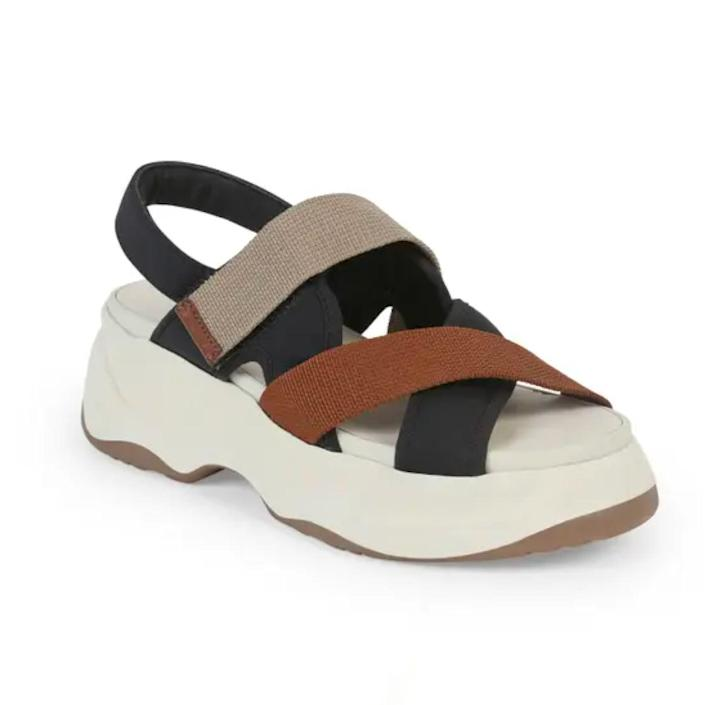 """If they're setting off on an international excursion where there'll be plenty of walking and photo opps, bless their feet with these comfy and <a href=""""https://www.glamour.com/gallery/best-summer-sandals?mbid=synd_yahoo_rss"""" rel=""""nofollow noopener"""" target=""""_blank"""" data-ylk=""""slk:stylish sandals"""" class=""""link rapid-noclick-resp"""">stylish sandals</a> from Vagabond. The shoes work with shorts, activewear, and dresses alike—and won't leave them in pain by the end of a long day. $130, Nordstrom. <a href=""""https://www.nordstrom.com/s/vagabond-shoemakers-essy-platform-sandal-women/5858037"""" rel=""""nofollow noopener"""" target=""""_blank"""" data-ylk=""""slk:Get it now!"""" class=""""link rapid-noclick-resp"""">Get it now!</a>"""