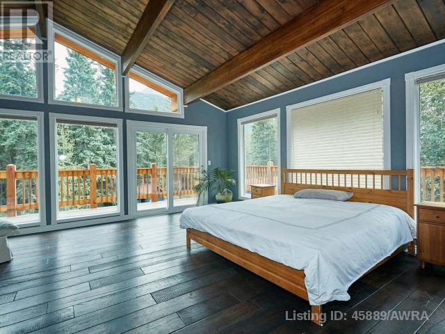 "<p><a href=""https://www.zoocasa.com/lac-des-arcs-ab-real-estate/5150273-14-heart-rise-lac-des-arcs-ab-t1w2w3-45889"" rel=""nofollow noopener"" target=""_blank"" data-ylk=""slk:14 Heart Rise, Lac Des Arcs, Alta."" class=""link rapid-noclick-resp"">14 Heart Rise, Lac Des Arcs, Alta.</a><br> There are five bedrooms in the home, including the master bedroom with floor-to-ceiling windows.<br> (Photo: Zoocasa) </p>"