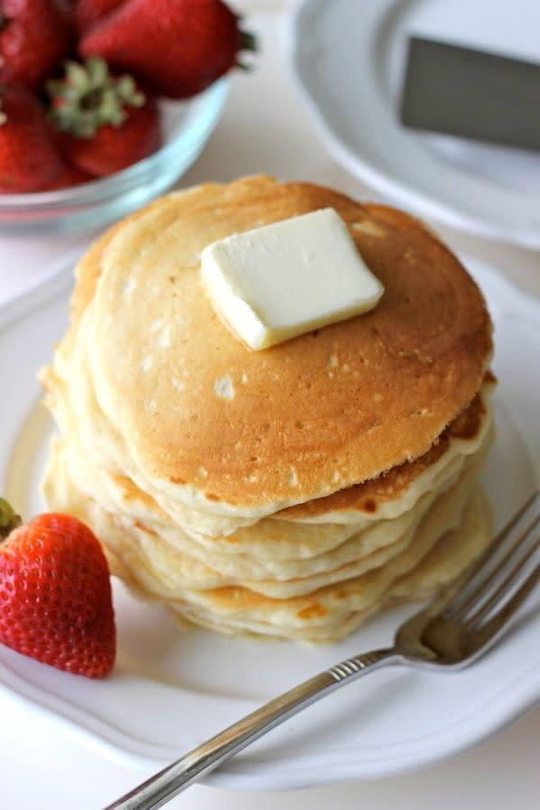 "<strong>Get the <a href=""http://damndelicious.net/2012/07/23/buttermilk-pancakes-with-strawberry-sauce/"" rel=""nofollow noopener"" target=""_blank"" data-ylk=""slk:Classic Buttermilk Pancakes recipe"" class=""link rapid-noclick-resp"">Classic Buttermilk Pancakes recipe</a> from Damn Delicious</strong>"